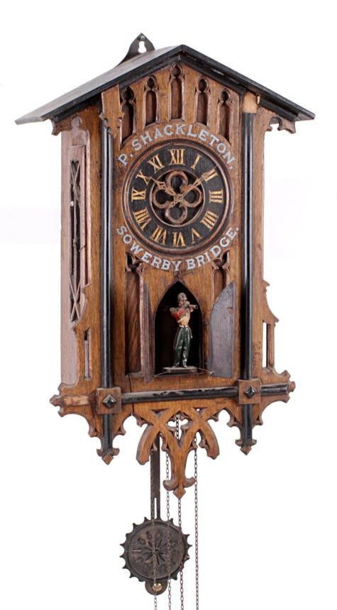 A German Black Forest carved oak weight-driven fou