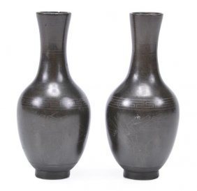 A pair of Chinese bronze vases, each of baluster f