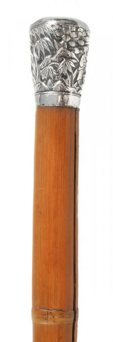 A Chinese bamboo brush handle, carved with three p