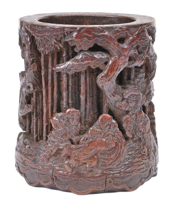 An Oriental bamboo brushpot, deeply carved with a