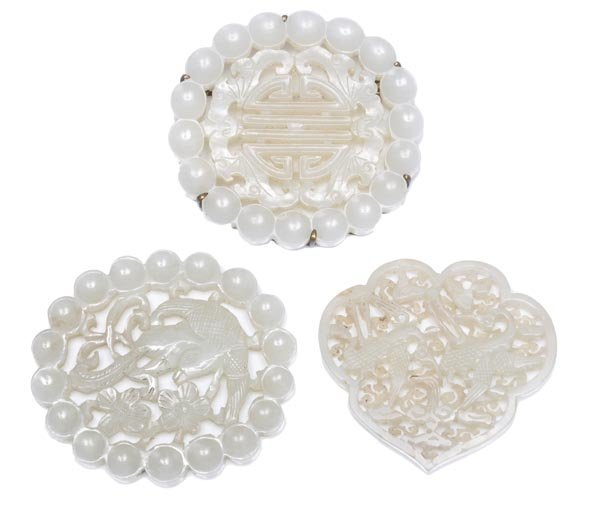 Three Chinese white jade openwork small plaques, c