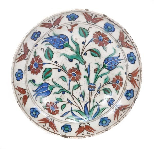 An Iznik pottery dish with a sloping rim and deep