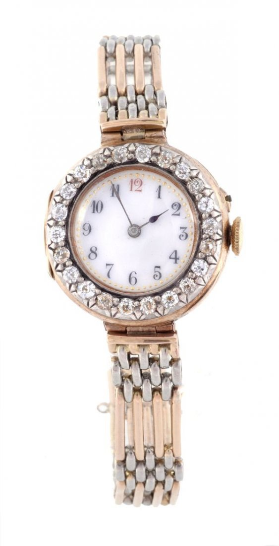 A lady's 18 carat gold and diamond cocktail watch,