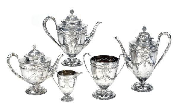 A Victorian Scottish silver vase shape four piece