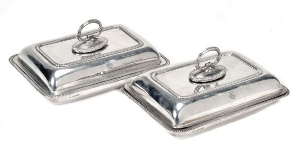 A pair of silver oblong entree dishes, covers and