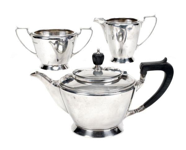 An Art Deco silver three piece tapering tea servic