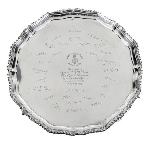 A silver shaped circular salver by Carrington  Co.