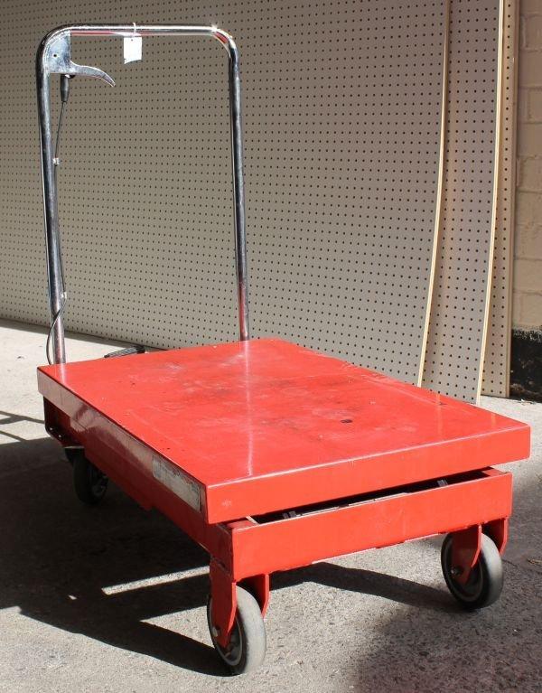A Sealey hydraulic trolley, with a foot pump pedal