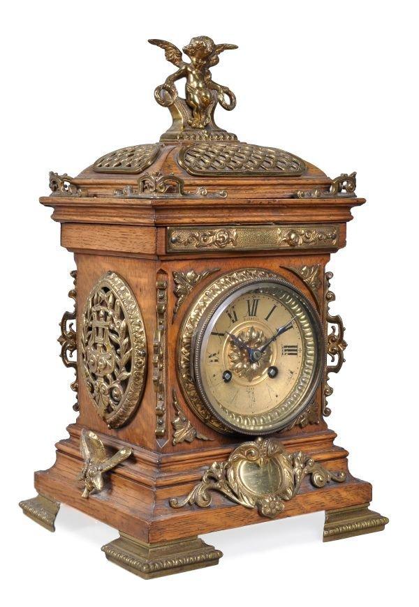 A French gilt brass mounted oak mantel clock retai