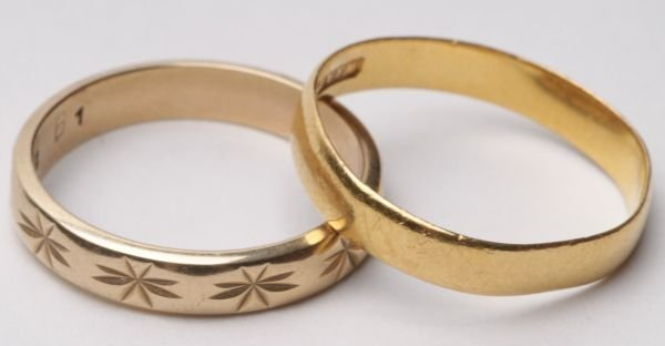 A 22 carat gold wedding ring, London 1953, with Co