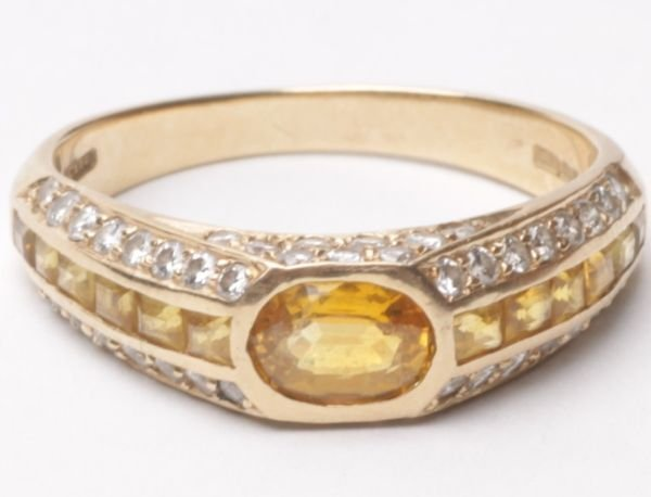 A yellow sapphire and diamond 18 carat gold dress