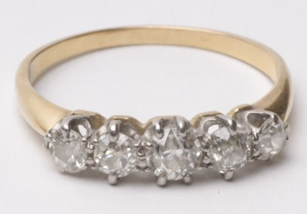 A five stone diamond ring, the graduated old brill
