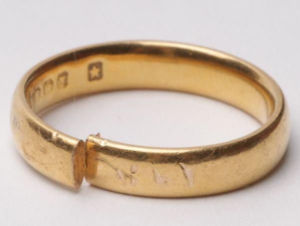 A 22 carat gold wedding ring, cut, 4.1g gross