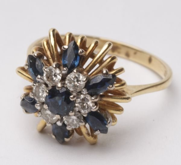 A diamond and sapphire cluster 18 carat gold ring,