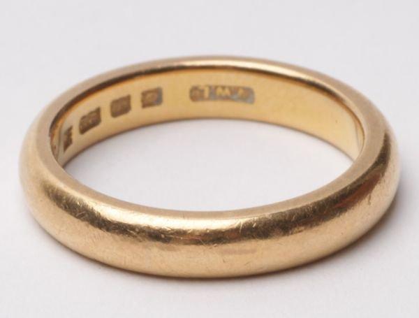 A 22 carat gold wedding ring, London 1929, of plai