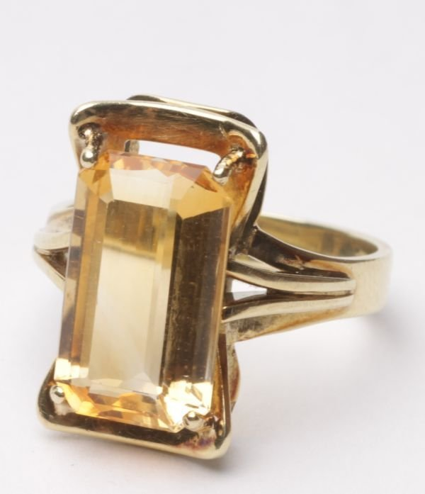 A citrine ring, the 14.5mm long step cut stone to