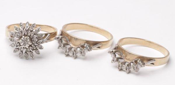 A diamond cluster ring on three separating 9 carat