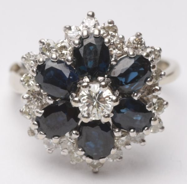 A diamond and sapphire cluster ring, the central b