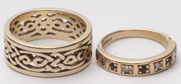 A diamond and sapphire 9 carat gold half hoop ring