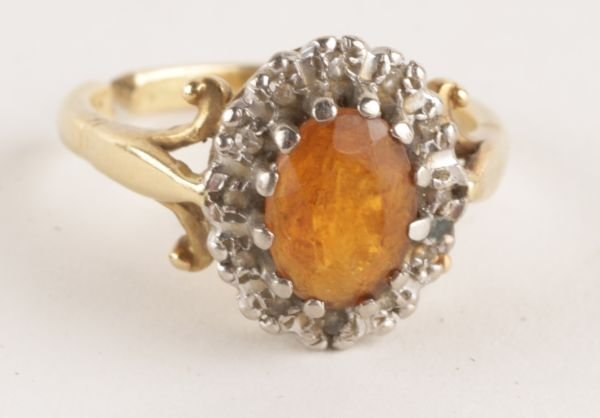 A citrine and diamond 18 carat gold cluster ring,