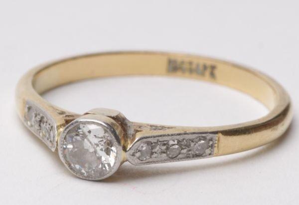 A single stone diamond ring, the millegrain set br