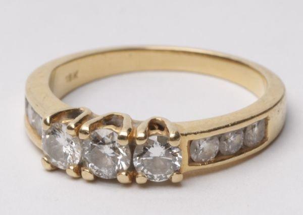 A three stone diamond 18 carat gold ring, with con