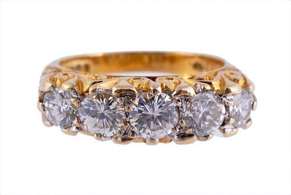 A diamond five stone ring, the brilliant cut diamo