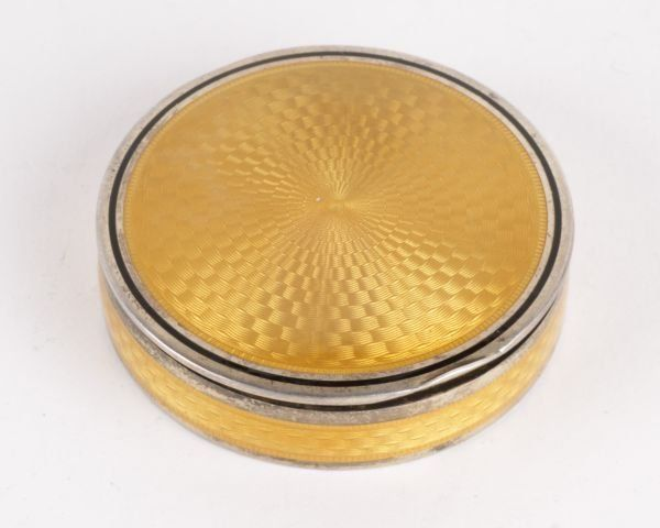 A French silver and yellow guilloche enamel circul