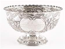 A late Victorian embossed silver pedestal rose bow