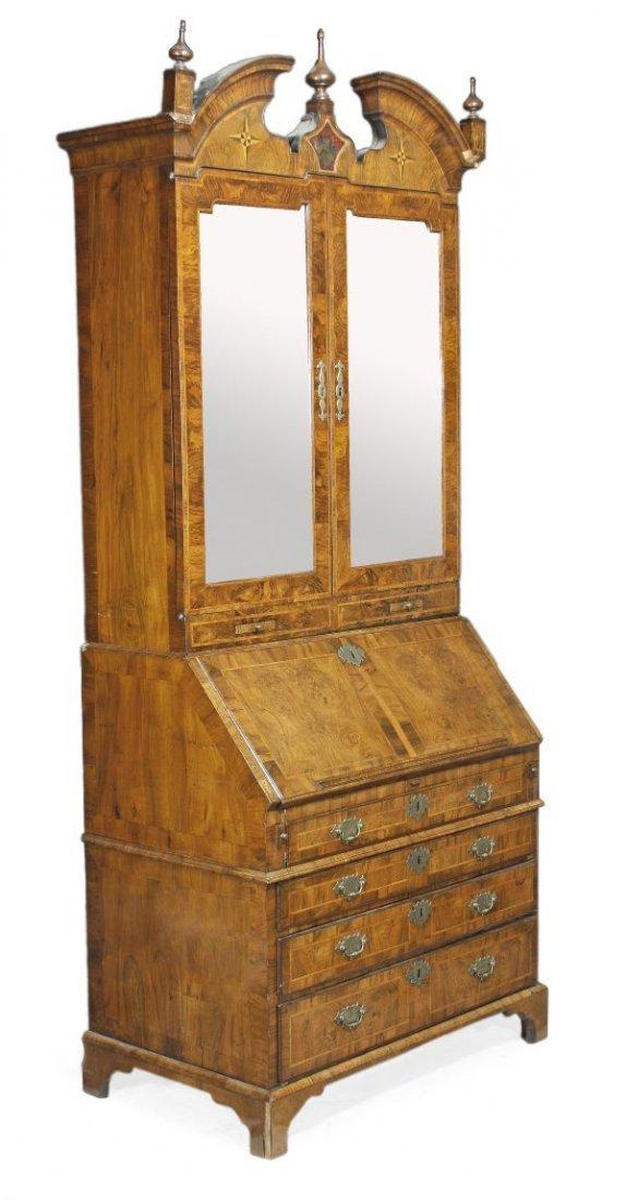 A George II figured walnut feather banded bureau b