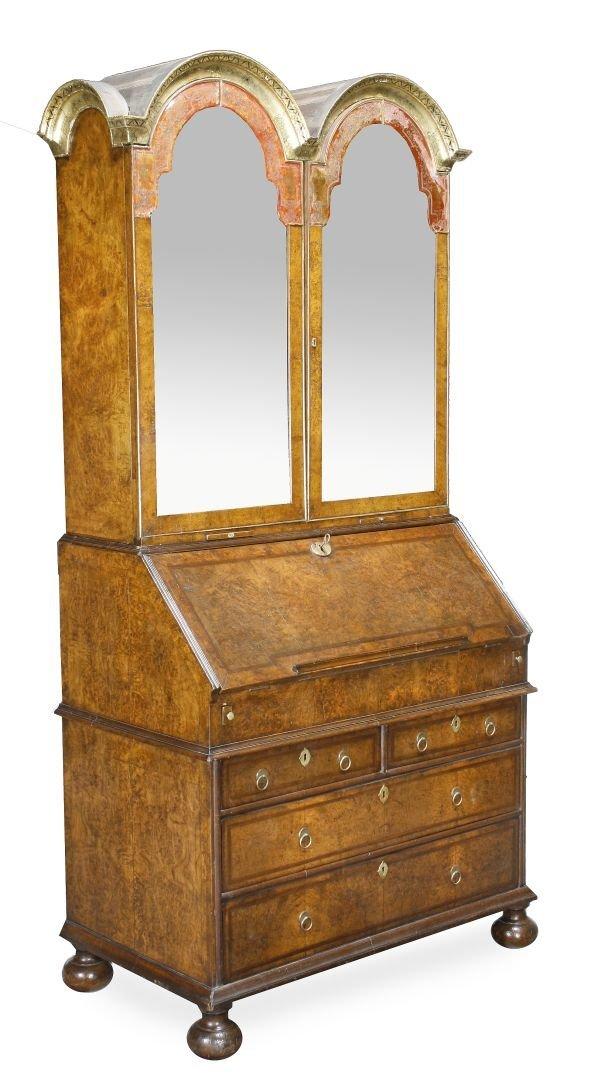 A Queen Anne burr walnut bureau bookcase,  circa 1