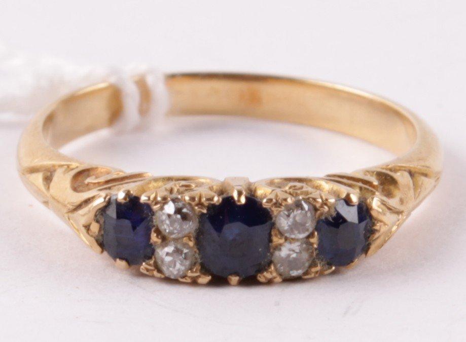 A sapphire and diamond ring, circa 1900, the three