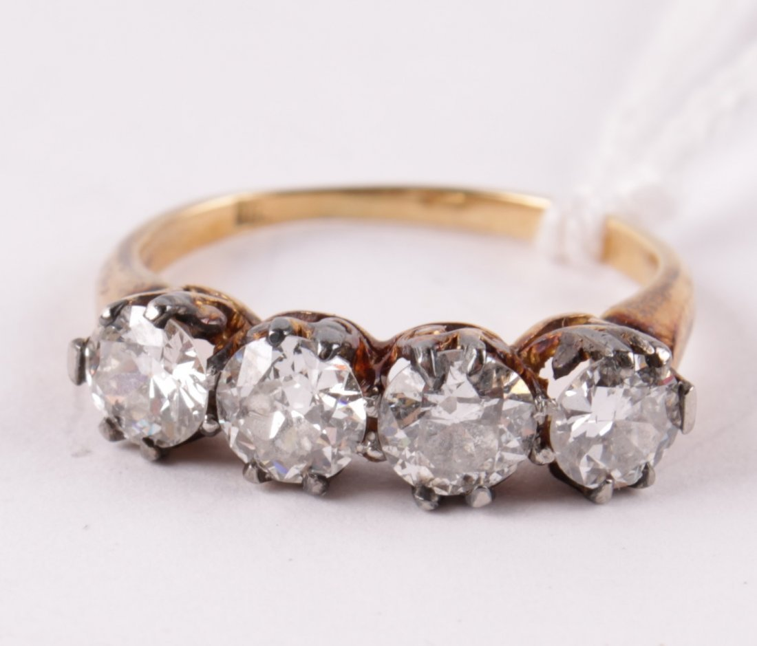 A four stone diamond ring, the uniform brilliant c