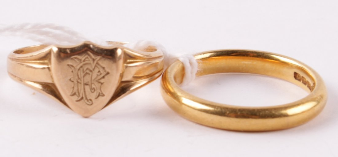A 22 carat gold wedding ring, of plain D section,