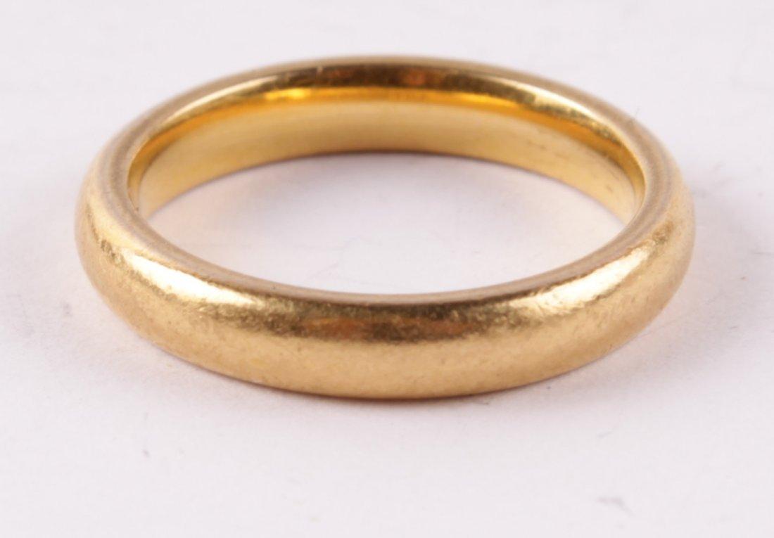 A 22 carat gold wedding ring Birmingham 1964 of
