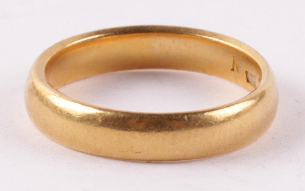 A 22 carat gold wedding ring, Birmingham 1924, of