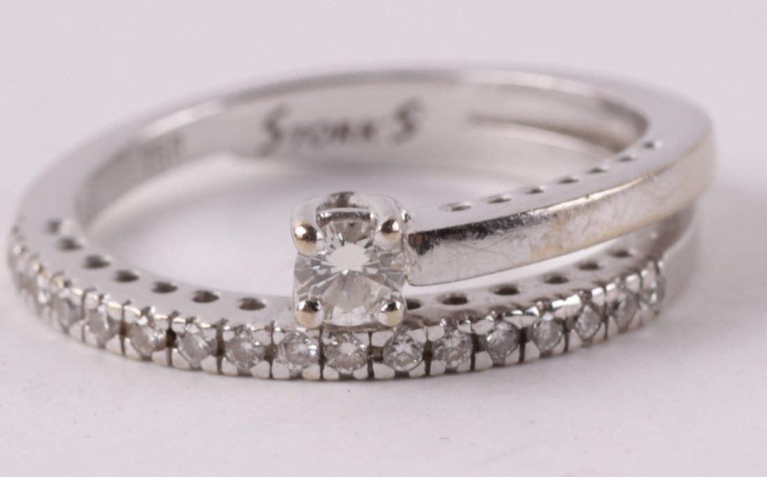 An unusual diamond ring, stamped 'Stork's', the do