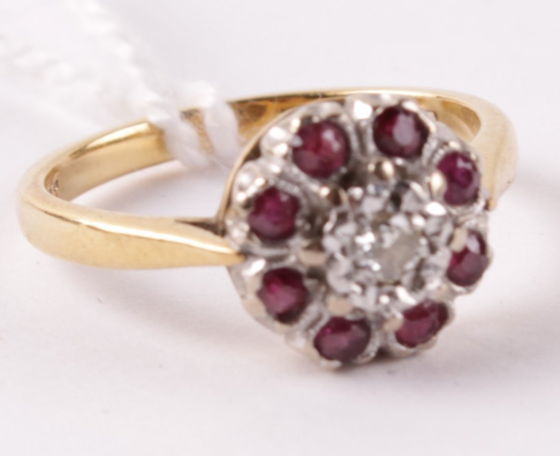 A diamond and ruby cluster ring, the central illus
