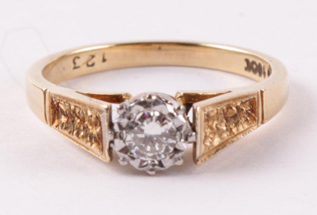 A diamond single stone ring, the illusion set bril