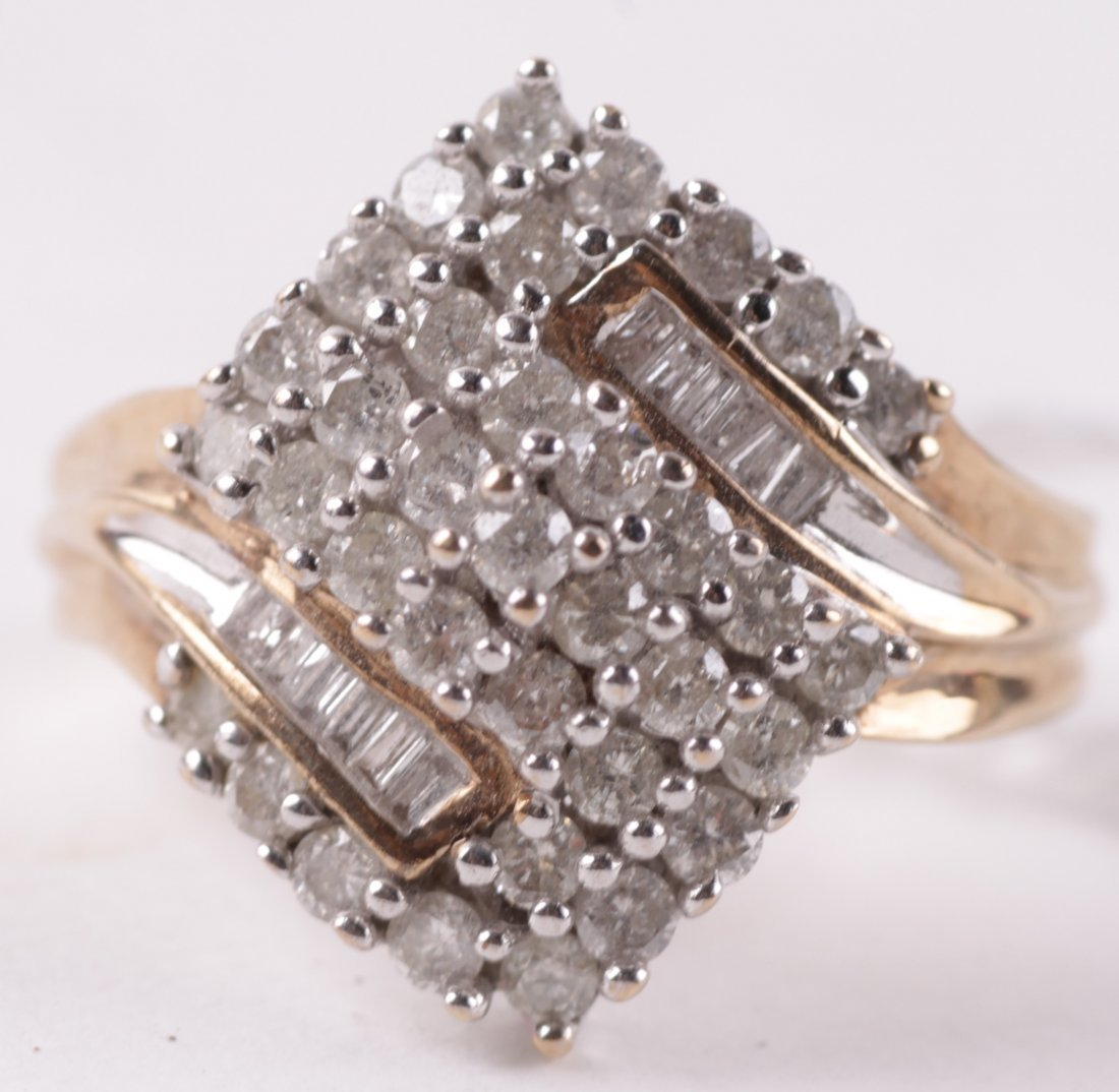 A diamond cluster dress ring, set with thirty five