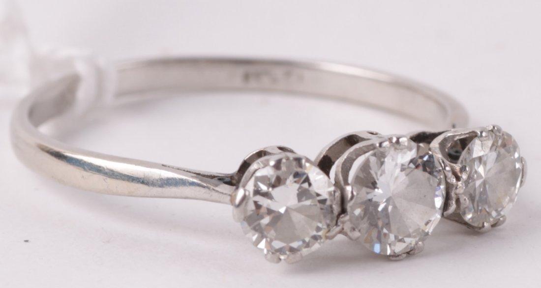 A three stone diamond ring, the graduated brillian