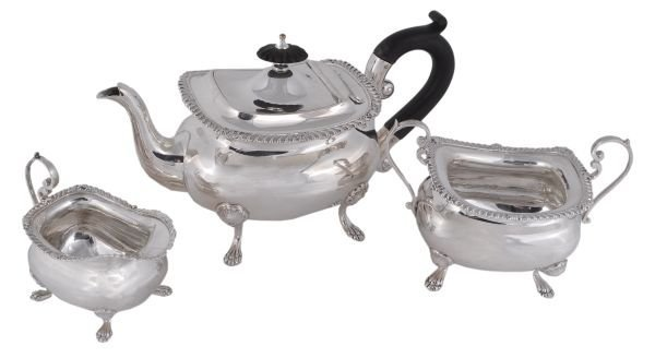 An Edwardian silver oblong baluster three piece te