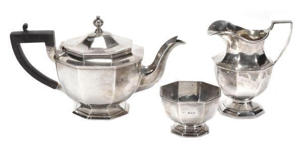 A matched silver octagonal three piece tea service