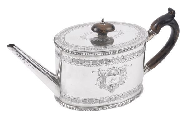 A Victorian silver oval straight-sided tea pot by
