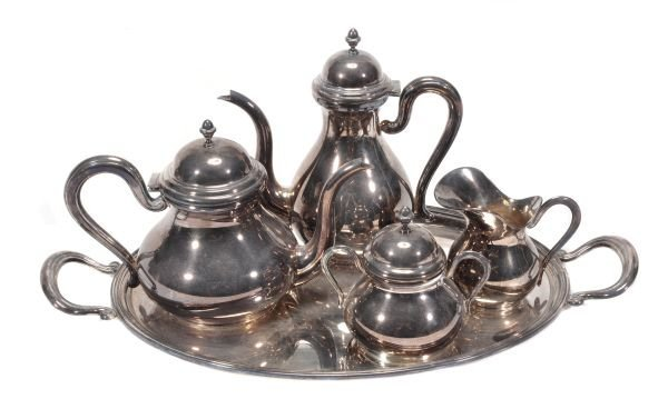 A silver four piece tea and coffee service on a tr