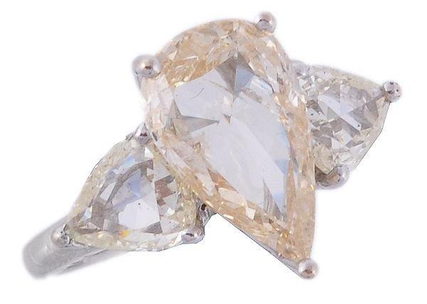 A diamond dress ring, the central pear cut diamond