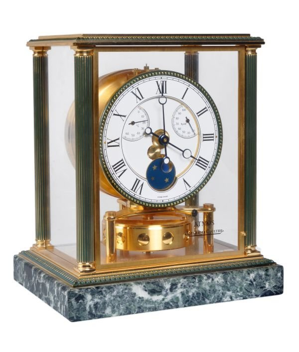 A brass and green marble 'Atmos' timepiece with mo