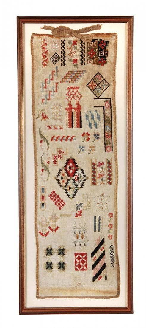 A woolwork sampler of linen, mid 19th century, with