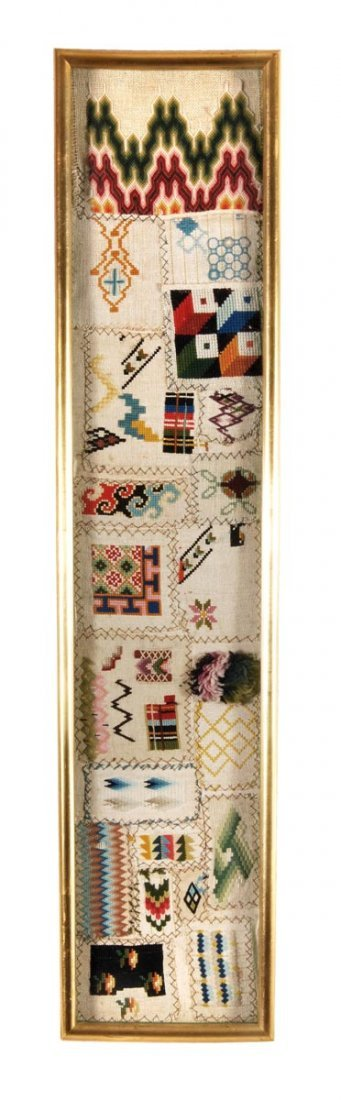 A woolwork sampler, mid 19th century, designed with