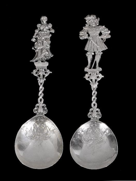 A pair of Dutch silver embossed spoons,  import ma